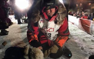 Mitch seavey at the finish line of the iditarod in 2018